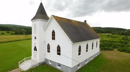 cape breton : Aerial shot above a beautiful small church at Cape Breton Island Stock Footage