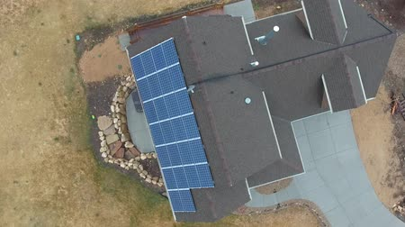 dekarz : Aerial shot of a home with solar panels on roof in spring Wideo