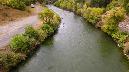 relaks : Aerial shot of a man fishing in the river