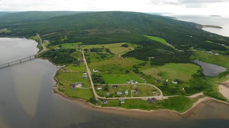 cape breton : Aerial shot of a small town and church on a coast Stock Footage