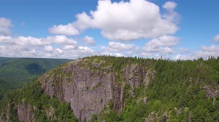 cape breton : Aerial shot of cliffs and a deep gorge and a mountain forest