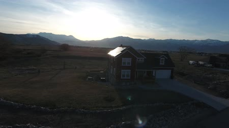 solar : Aerial shot of house with solar and mountains at sunset with tree