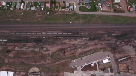 caboose : An aerial dolly shot of train depot and roundhouse with rail cars Stock Footage