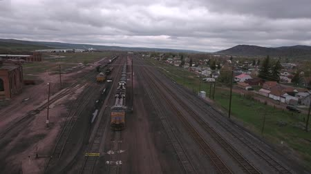 caboose : An aerial shot of a train depot and rail cars Stock Footage