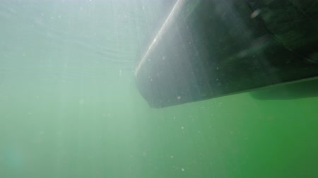 makineleri : An underwater shot of a pontoon boat on a lake