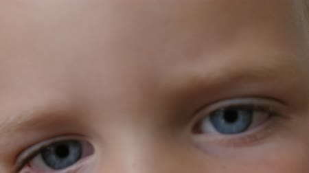 irys : Boy with amazing eyes stares into camera Wideo