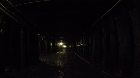 podzemní : Camera jib shot through a dark coal mine at glace bay