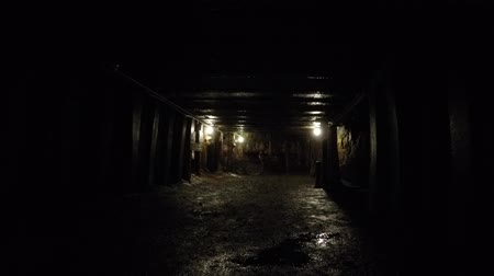 eixo : Camera moving shot through a dark coal mine at glace bay Stock Footage