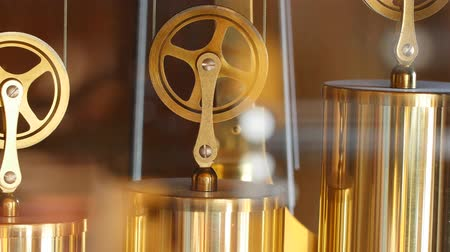 bronz : Closeup of slow dolly shot of pendulum on grandfather clock