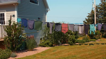 varal : Clothes drying on line blowing in a wind