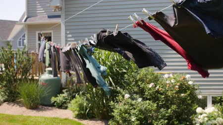 varal : Clothes hanging on a line blowing in a wind