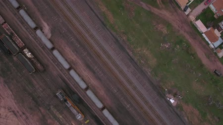 caboose : Cool aerial dolly shot of train depot and rail cars Stock Footage