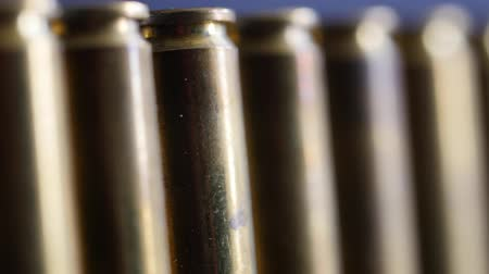mass shooting : Dolly shot of large caliber bullets in a production line Stock Footage