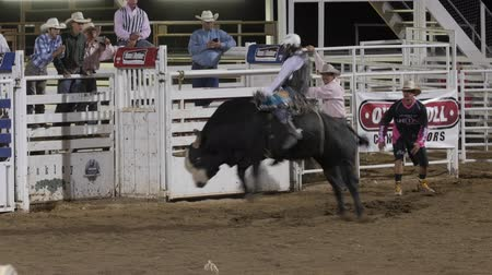секунды : Editorial a cowboy riding a big bull at the PRCA Oakley rodeo slow motion
