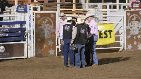 арена : Editorial medics helping injured bull rider at a PRCA rodeo
