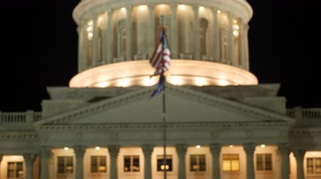 burocracia : Flag flies at the Utah State Capitol at night rack shot Stock Footage