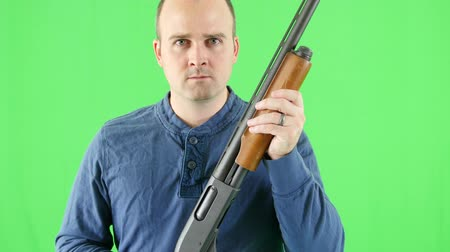 terrorizmus : Green screen shot of shooter with a shotgun at camera Stock mozgókép