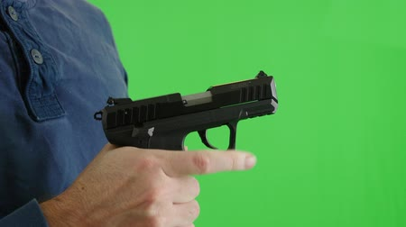 terrorismo : Green screen shot of shooter with pistol