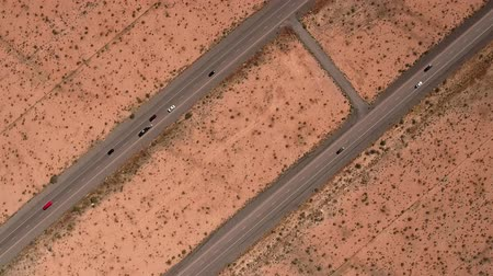 nevada : High rotating aerial shot cars traveling on highway in a desert