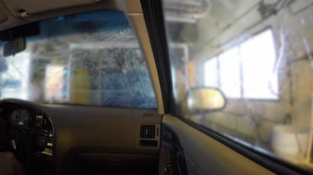 yıkayıcı : Interior of car being cleaned in a car wash