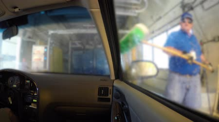 yıkayıcı : Interior of a car being cleaned in a car wash Stok Video