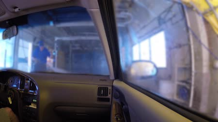 cleaner : Interior of a car being cleaned in car wash
