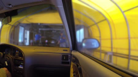 aeróbico : Interior of car being cleaned in car wash Stock Footage
