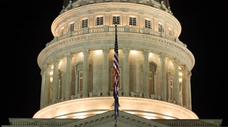 burocracia : Lights on the Utah State Capitol dome with flags tilting shot Stock Footage