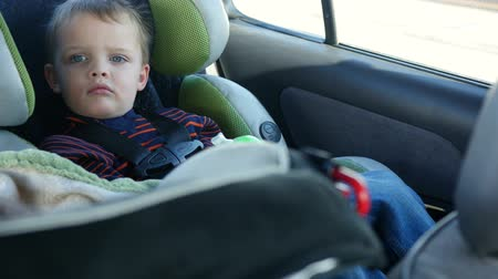 carseat : Little boy riding in a car seat