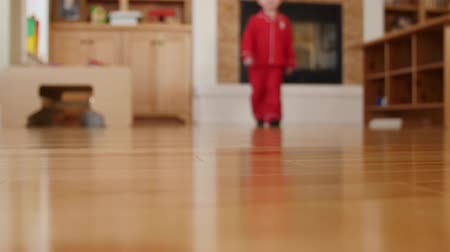 boŻe narodzenie : Little boy walks around house in pajamas and slippers