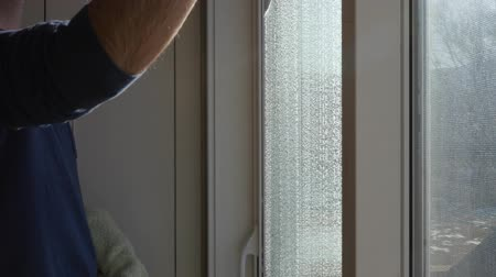 cleaner : Man cleans house windows