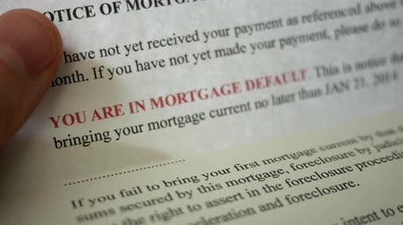 dever : Man reading final notice foreclosure letter from bank