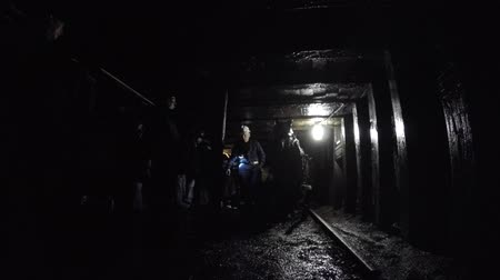 eixo : Shot in dark coal mine in glace bay with tourists families