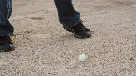 тройник : Slow motion of a man hitting a golf ball out of sand trap