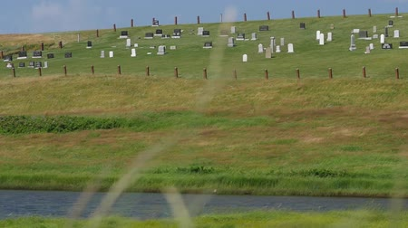 cape breton : Slow motion of grass in wind and small cemetery Stock Footage