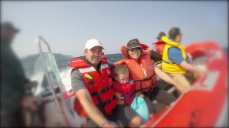 zodiak : Small boat with family while on a whale watching ride