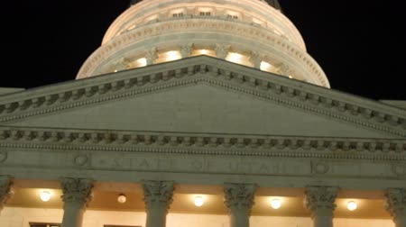 burocracia : The lights on Utah State Capitol dome with flags tilting shot Stock Footage