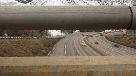 samochody : Trucks and cars driving on I-80 highway a timelapse dolly shot Wideo