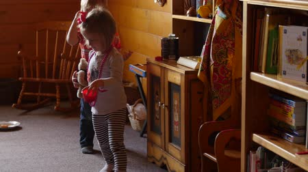 küçük kız : Two little kids playing house together Stok Video