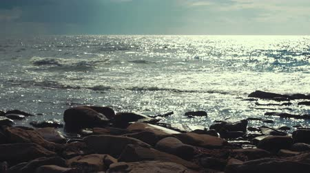 cape breton : Waves fall on a gorgeous rocky ocean coastline at sunset