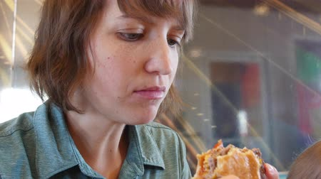 картофель фри : Woman eating fast food at a table for lunch