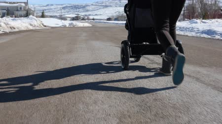 incecik : Woman walking her baby boy in stroller