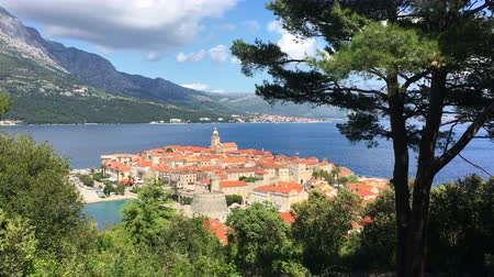 hırvatistan : Panoramic view of the historic town of Korcula on a beautiful sunny day with blue sky and moving clouds in summer, Island of Korcula, Dalmatia, Croatia