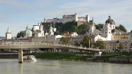 mozart : Panoramic view of the historic city of Salzburg with Fortress Hohensalzburg in the background as seen from river Salzach in Salzburg, Austria