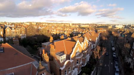 properties : Flying above London surburban houses and apartments aerial view at dawn on sunny day