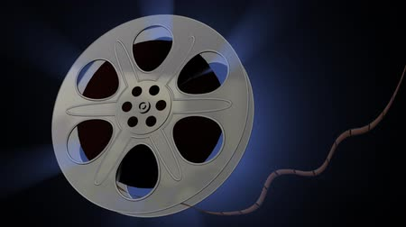 régi : Film Reel Blue Aura (HD Alpha). Computer rendering of a film roll with a blue dusty aura coming through the metal spaces. Includes Alpha Channel for compositing in the end track. Stock mozgókép