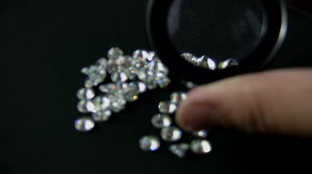drágakő : Diamond Inspection Close Up (HD). Large Round cut diamonds inspected by a jewelers loupe for flaws and quality.