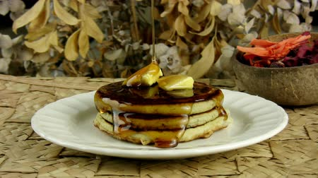 блин : Pancakes With Dripping Maple Syrup (HD). Stack of pancakes with butter and Maple Syrup dripping slowly from above to melt the butter and cover the tower of flavor.
