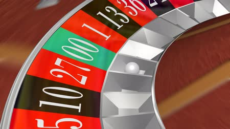 рулетка : Roulette Wheel Landing On Double Zero (HD). Animation of a Roulette wheel seen close up spinning while the ball bounces and lands on double zero. Motion blur and ray-tracing used.