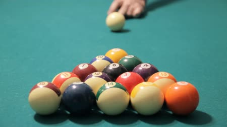 játék : Pool Game Start Shot (HD 24p). Pool game start breaking ball triangle formation. Male hand and Cue seen behind.